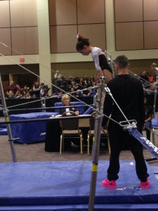 Coach Kyel helping Alanah Martinez on the uneven bars. Palm Springs, CA.
